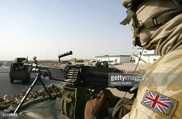 British soldier mans his gun while patrolling near the port of Umm Qasr south of Basra 06 August 2004 Britishled troops were targetted in the...