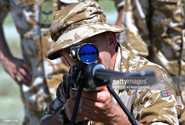 British soldier of the 7th Battalion rifle regiment look through the scope of a Black Arrow sniper rifle at the Krivolak army training center 100 km...