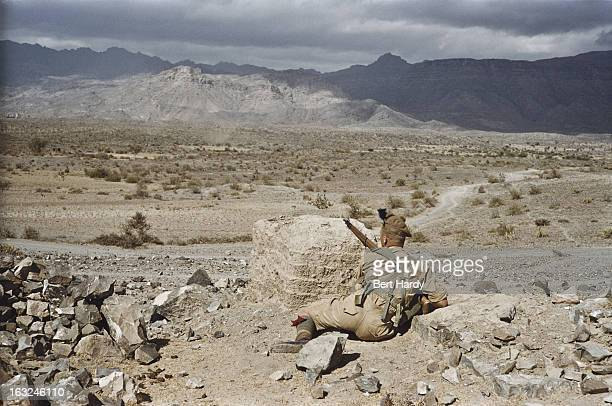 A British soldier of the Queen's Own Cameron Highlanders regiment in the desert near Aden during a local insurgency against British forces circa 1957...
