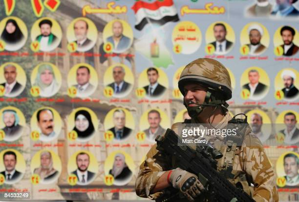 British Soldier patrols along a street decorated with election posters for the forthcoming polls on January 29, 2009 in Basra, Iraq. Many areas in...