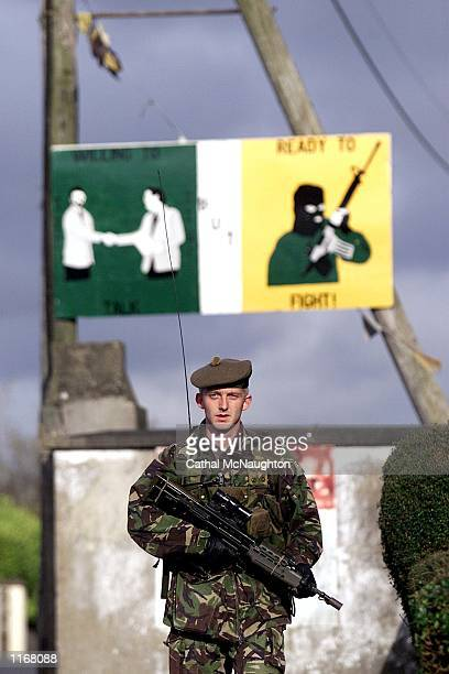 British soldier patrols October 24 2001 in the village of Crossmaglen Northern Ireland Four British Army security installations are to be dismantled...