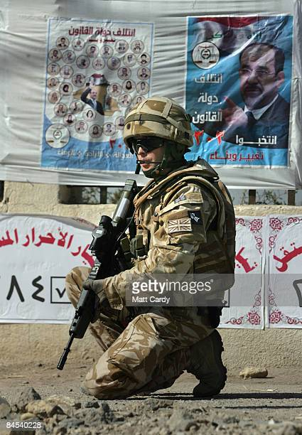 British soldier patrols the streets close to the 50 Brigade MiTT at the Iraqi naval base in the Al Maqil district on January 29 2009 in Basra, Iraq....