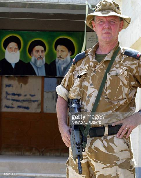 A British soldier patrols the streets of Qurna a town of 250 some 75 north of Basra 12 June 2003 British forces made up of 360 soldiers handed over...