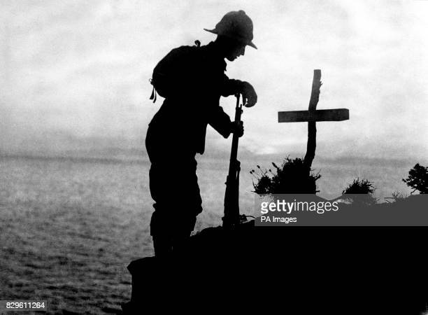 A British soldier pays his respects at the grave of a colleague near Cape Helles where the Gallipoli landings took place