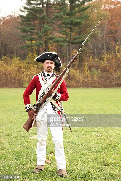 british soldier poses with rifle - colonialism stock photos and pictures