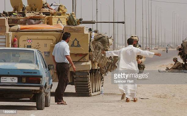 British soldier searches a man entering teh city April 5 2003 in Basra Iraq British forces have slowly been advancing on the strategic southern city...