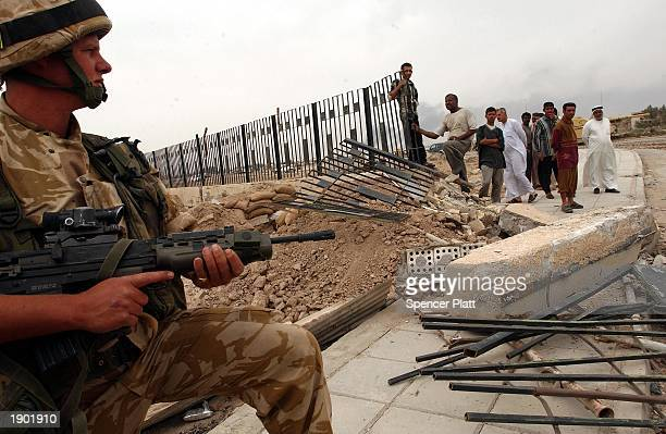British soldier stands in the entrance to the bombed-out Basra University April 7, 2003 after forces occupied most of the strategic southern Iraqi...