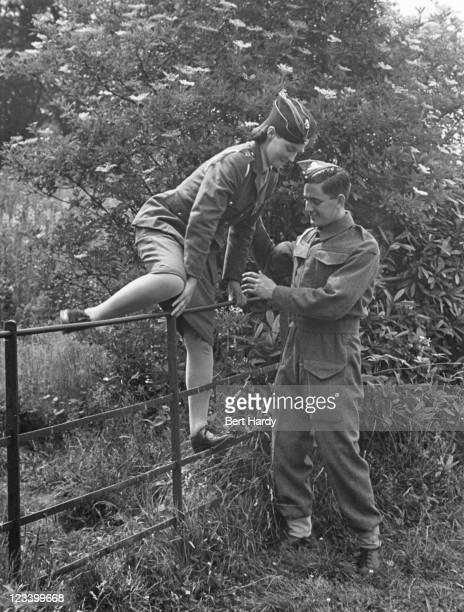 A British soldier takes a uniformed young lady for a country stroll during World War II 1941 Original Publication Picture Post 819 Boy Meets Girl...