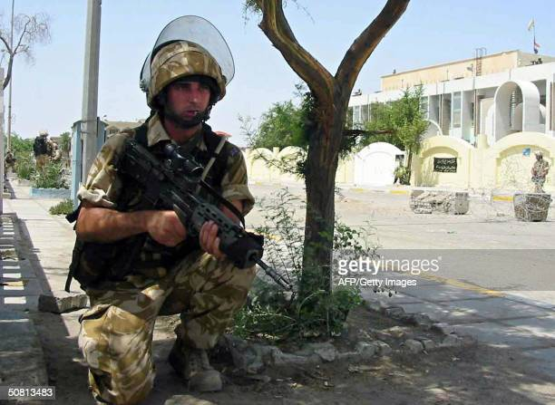 British soldier takes position 08 May 2004 during clashes with militiamen loyal to Shiite Muslim radical leader Moqtada Sadr in the southern city of...