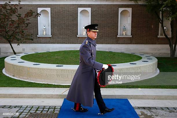 British soldier walks past the Flanders' Fields Memorial Garden before it was the opened at Wellington Barracks on November 6 2014 in London England
