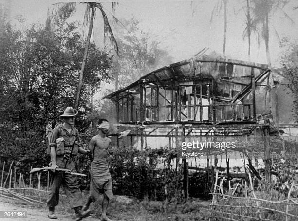 A British soldier with a Japanese sniper he captured near Pegu Burma