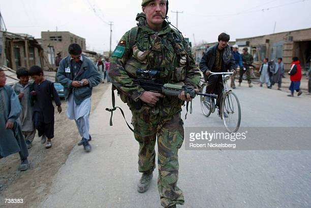 British soldier with the ISAF peacekeeping force goes on a night patrol April 5, 2002 on the outskirts of western Kabul. Armed gangs that have been...