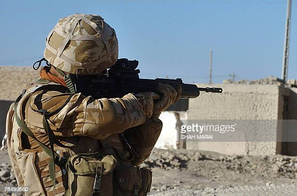 British soldier with the NATO-led International Security Assistance Force walks during a patrol in the town of Musa Qala in Helmand province, 15...