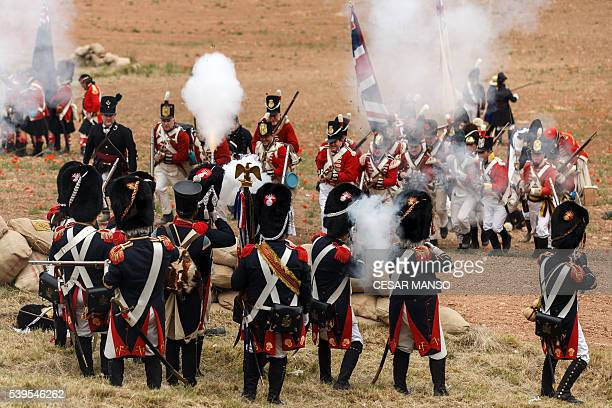 British soldiers and French ones fire with their muskets during an historical reenactment recreating the siege of Burgos Castle battle during the...