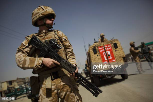 British soldiers and the Afghan National Police secure the site of a suicide bomb blast on August 18 2009 in Kabul Afghanistan Seven people were...