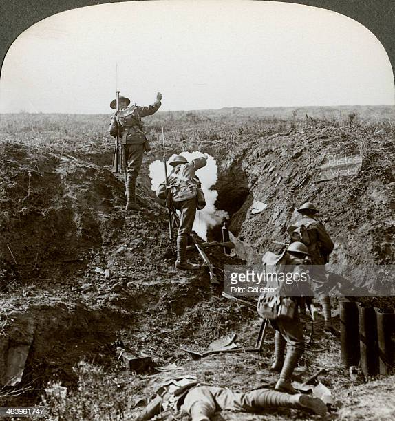 British soldiers attacking the Hindenburg Line World War I 19171918 Soldiers bombing Germans out of their deep dugout with grenades The Hindenburg...