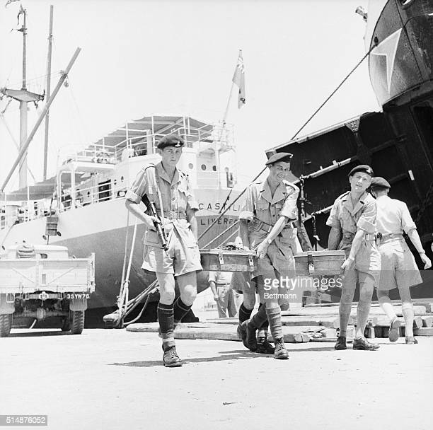 British soldiers carry money boxes along a pier in Famagusta as the British evacuate from the Suez Canal The evacuation was provoked by Egyptian...