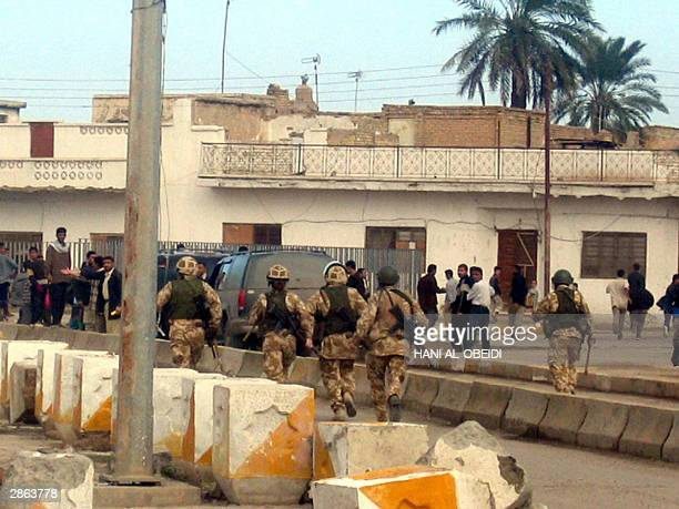 British soldiers clash 12 January 2004 with Iraqi protestors advancing at a local government headquarters in the southern city of Amara the scene of...