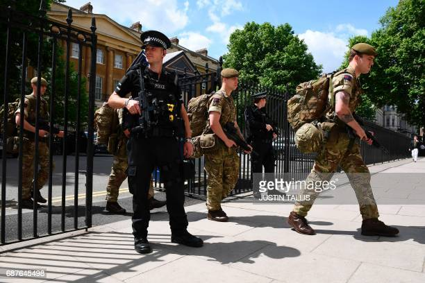 British soldiers enter a Ministry of Defence building near to New Scotland Yard police headquarters near to the Houses of Parliament in central...