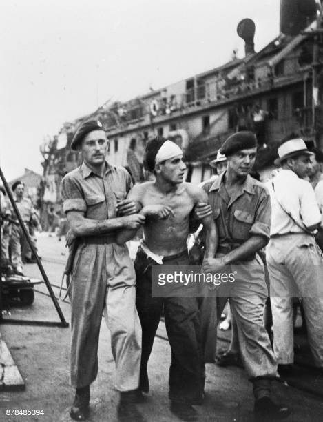 British soldiers escort an illegal Jewish immigrant before to be deported, 18 November 1947 in Haifa. British authorities issued in 1939 the...