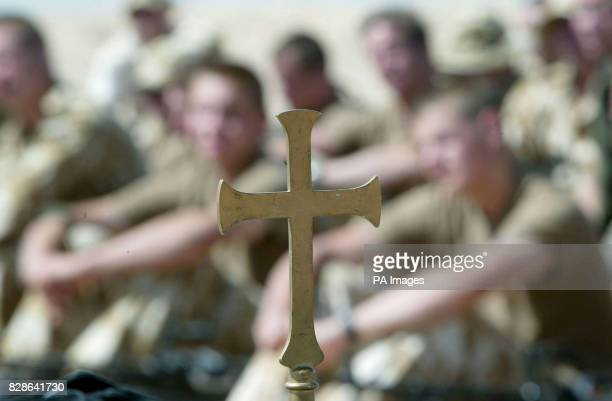British soldiers from 29 Commando Regiment Royal Artillery listen to a sermon from the Regimental Padre during a field service in the Kuwaiti desert...