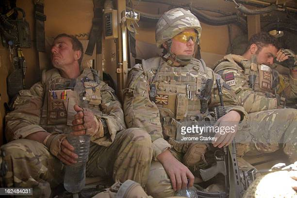 CONTENT] British soldiers from a Royal Engineers High Assurance Search Team grieve the loss of a comrade killed in an explosion near Karim Qalay hill...
