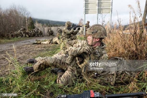 British soldiers from Anzio Company of the Duke of Lancaster Regiment engeging in a mock fire fight with parts of the 232nd German Mountaion Infantry...