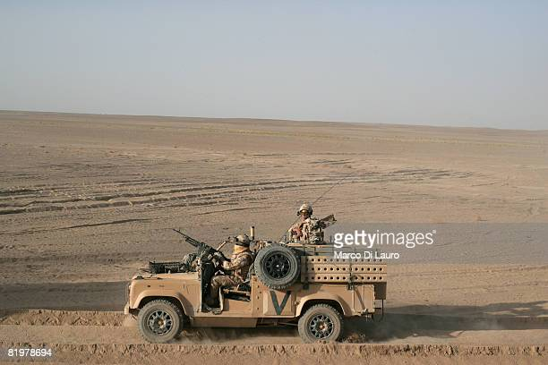 British soldiers from the 13 Air Assault Support Regiment drive through the desert on duty as a close protection force for a convoy of trucks during...