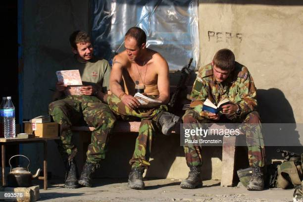British soldiers from the 2nd Batallion Parachute regiment relax in warm winter weather at their barracks January 21 2002 in Kabul