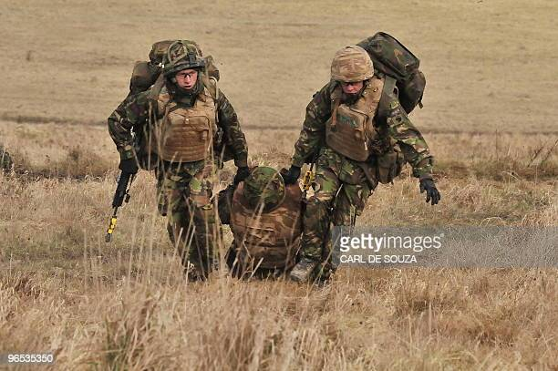 British soldiers from the 4th Mechanized Brigade are pictured after a training exercise on Salisbury Plain Wiltshire in southern England on February...