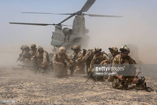 British Soldiers from the 5th Regiment of the Royal Artillery are deployed from Chinook helicopters at the Dwyir Forward Operation Base , May 13,...
