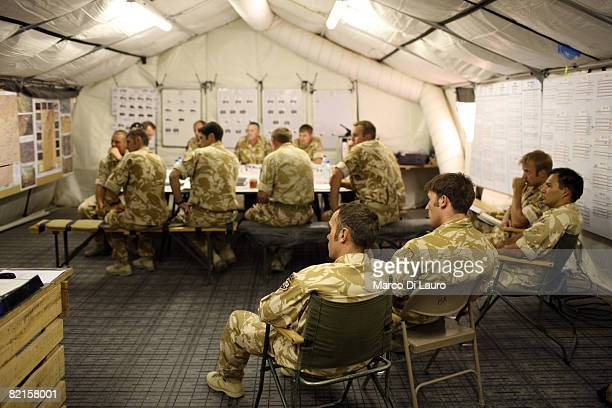 British Soldiers from the 7th Parachute Regiment Royal Horse Artillery attend their daily morning briefing on July 30 2008 in Camp Bastion Helmand...