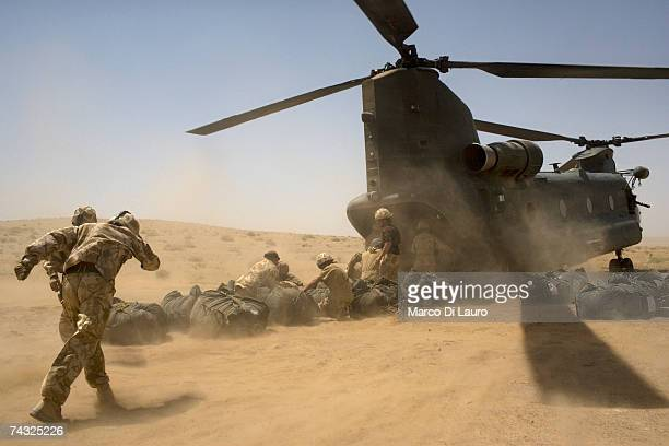 British soldiers from the B Squadron of the Light Dragoons Regiment load into a Chinook helicopter delivering supplies as they camp in a location in...