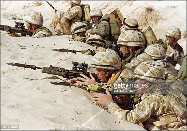 British soldiers from the First Stafford well known as the 'Desert Rats' stand in a trench 06 January 1991 somewhere in Saudi desert ready to attack...