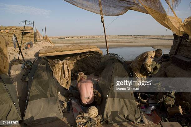 British Soldiers from the Grenadier Guards and the Royal Artillery Regiments wake up at their combat security outpost on May 15 2007 in Southern...