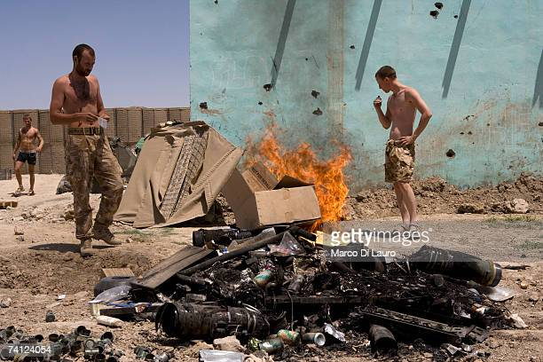 British Soldiers from the Grenadier Guards Regiment are seen as they burn trash at their combat security outpost at the Delhi Patrol Base in a...