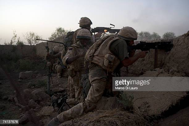 British Soldiers from the Grenadier Guards Regiment fire at Taliban insurgents during a fighting patrol into Taliban territory outside the Delhi...