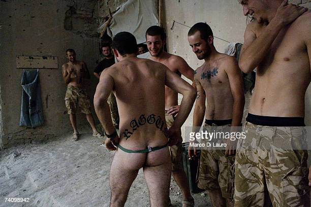 British Soldiers from the Grenadier Guards Regiment joke about at their compound at the Delhi Patrol Base a location in the desert in the Garmsir...
