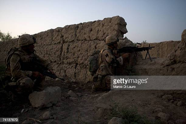 British Soldiers from the Grenadier Guards Regiment prepare to fire at Taliban insurgents during a fighting patrol into Taliban territory outside the...