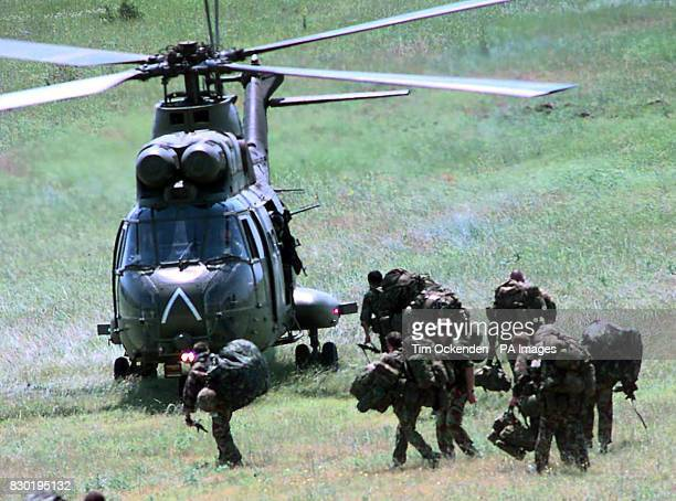 British soldiers from the Parachute Regimnent board a Puma helicopter at the Petrovac base in Macedonia. Within days 000 British troops could be...