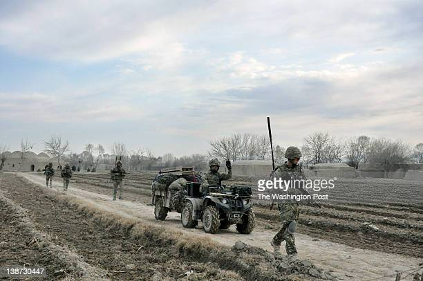 British soldiers from the Yorkshire Regiment walk during a patrol to a checkpoint outside the Forward Operating Base Khar Nikah in Nahre Saraj...
