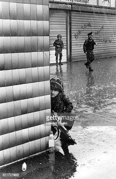 british soldiers ion patrol in west belfast - falls road stock pictures, royalty-free photos & images