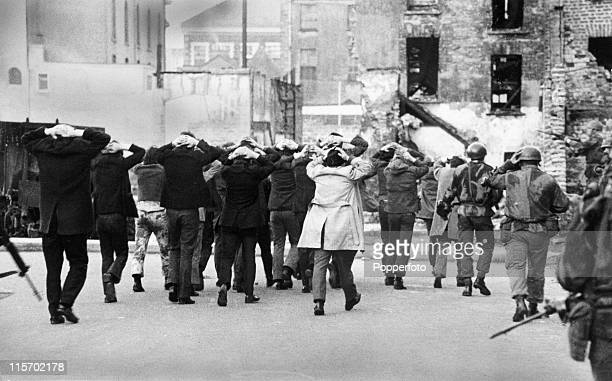 IRA terrorist suspects are rounded up by British soldiers on Bloody Sunday in Londonderry Northern Ireland when 13 Roman Catholics were killed 30th...