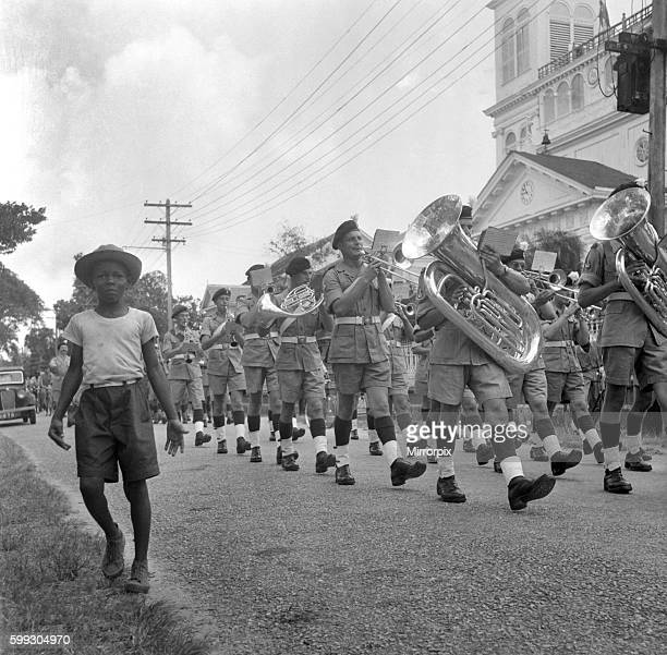 British soldiers marching in Georgetown British Guiana watched by local citizens The troops were sent to calm a serious constitutional crisis whaich...