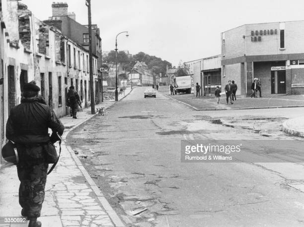British soldiers of the Royal Regiment of Fusiliers patrol the streets in the Bogside area of Derry in the tense aftermath of the 'Bloody Sunday'...