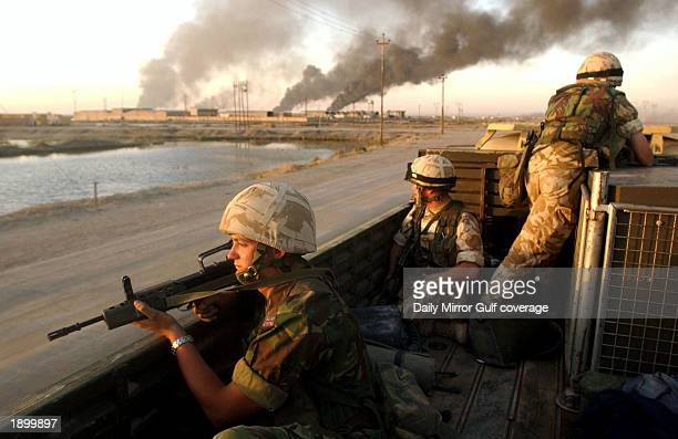 """British soldiers of the Royal Scots Dragoon Guards, the 7th Armoured Brigade """"The Desert Rats, patrol April 4, 2003 in the southern Iraq town of..."""