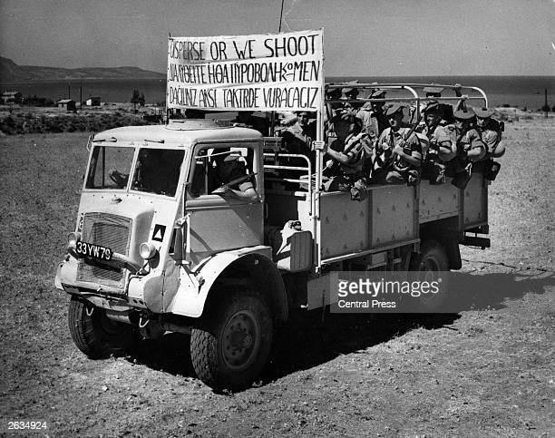 British soldiers on duty in Cyprus prepare for the possibility of rioting during a planned 24 hour strike with a menacing and deadly trilingual...