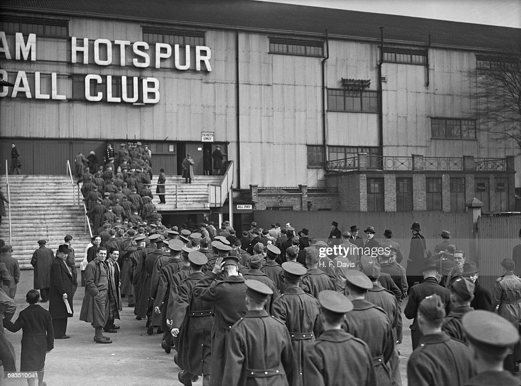 British soldiers on leave, queuing outside Tottenham Hotspur's White Hart Lane ground, London, before a match between Arsenal and Chelsea, 23rd March 1940.
