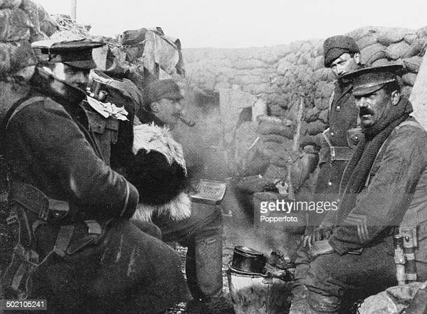 British soldiers smoking pipes after cooking a meal in their trench World War I 1915