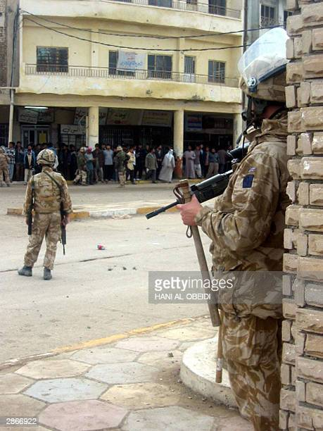 British soldiers stand guard as tensions remain high 13 January 2004 in the southern city of Amara 365 kilometres southeast of Baghdad following the...